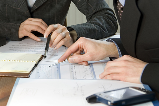 Two business people looking at business valuation documents